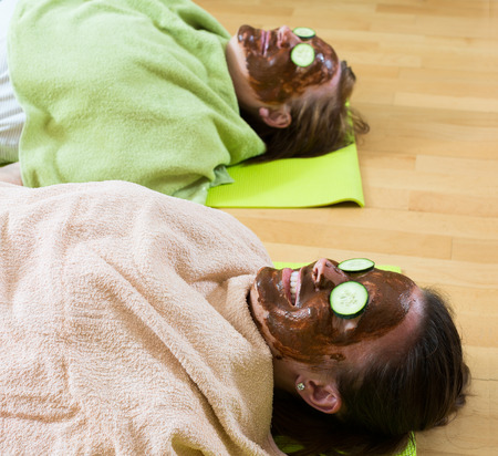 cognate: Two women relaxing with a homemade mask for skin face Stock Photo