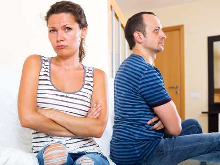 sorting out: Two sad adult sorting out their relationship. Focus on the woman
