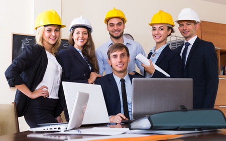 co operation: Office portrait of positive business team with architects, designers and constructors. Selective focus Stock Photo
