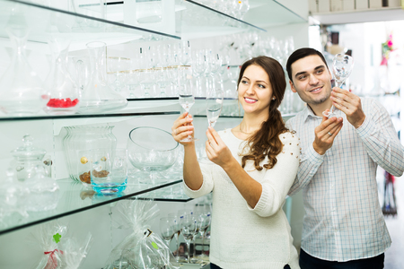 25 35: Young family couple buying glassware in cookware shop Stock Photo