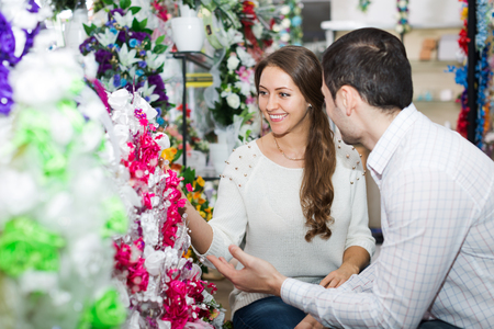25 35: husband and wife buy flowers at the store Stock Photo