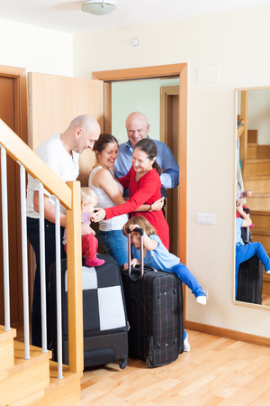 relatives: Happy family seeing off the relatives to vacations Stock Photo