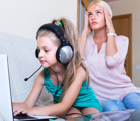 internet porn: Frustrated blonde woman catching her daughter watching forbidden site online