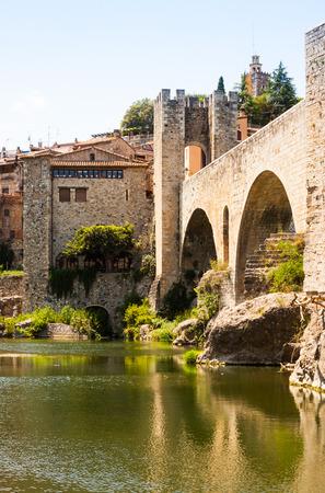12th century: Medieval stone bridge wit gate, built in 12th century. Besalu, Catalonia