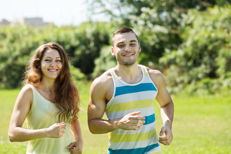 twenty two: young friends jogging on summer morning