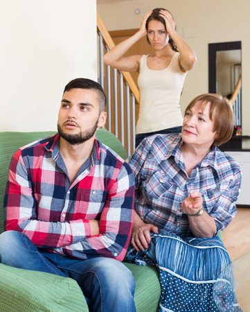 son in law: sad american family quarrels with the husbands mother Stock Photo