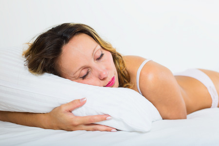 30 to 35: Beauty woman sleeping on white pillow in bed Stock Photo