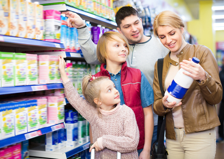 pasteurized: Family of four buying pasteurized milk in supermarket