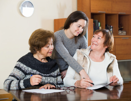 65 70: Senior cute smiling women making will at public notary office