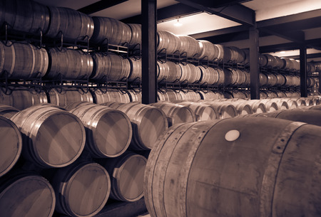 wine barrel: Aged photo of old cellar with  barrels Stock Photo