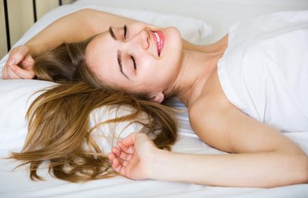 wellness sleepy: Portrait of attractive longhaired blonde girl awake in bed