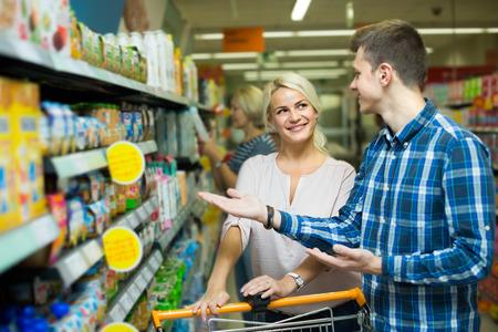 ordinary: Ordinary family purchasing infant food Stock Photo