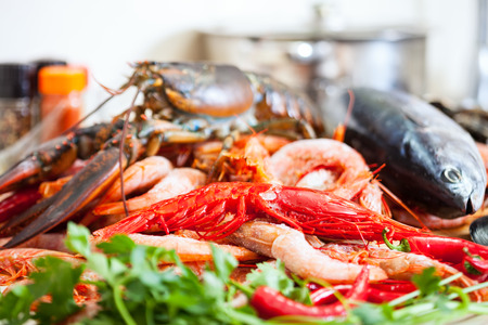 nutricion: Still life with fresh raw seafoods and fish in domestic kitchen Stock Photo