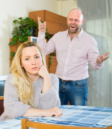 jackboot: Angry man and unhappy woman having quarrel at home Stock Photo