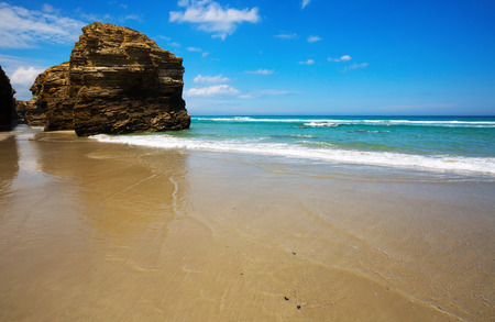 paradise bay: Rocks at sand beach in summer day. Atlantic Ocean coast of Spain