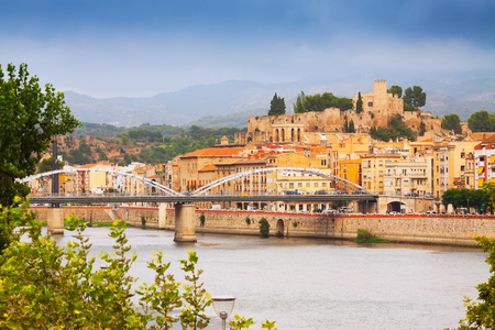 ebre: Day view of Ebro river with bridge and Suda Castle in Tortosa. Catalonia,  Spain
