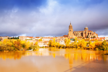 castile: Salamanca Cathedral from  River  in autumn. Castile and Leon, Spain Stock Photo