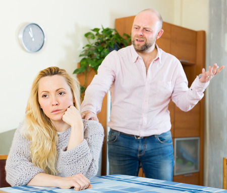 boy lady: Angry man and unhappy young woman having quarrel at home