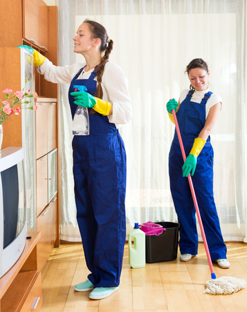 room service: Smiling female workers cleaning company ready to start work Stock Photo