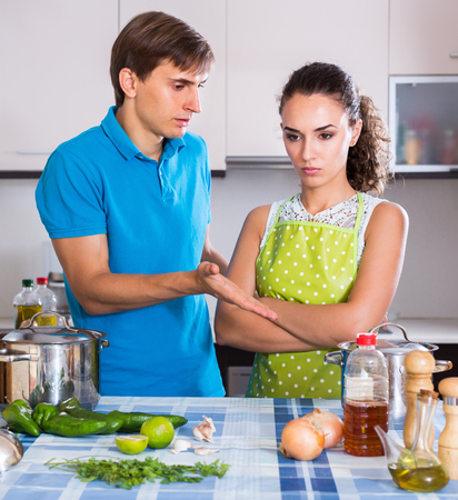 criticize: Unhappy couple having quarrelling and criticize indoors Stock Photo