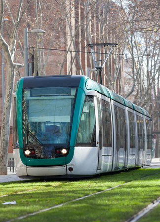 ordinary: Ordinary tram on street of city Stock Photo