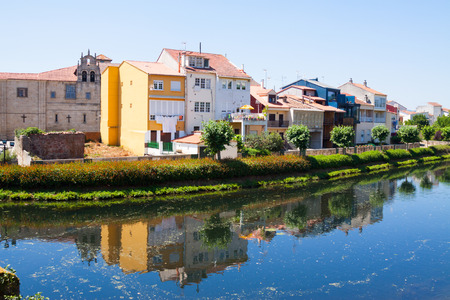 historical reflections: river and old houses at Monforte de Lemos in summer day. Galicia