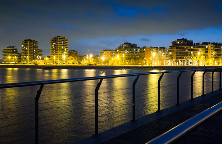 fabrica: Pier at beach of Badalona  in night time.  Spain Stock Photo