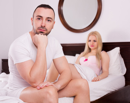unsatisfied: Unsatisfied wife and sad young husband having difficulties in bed