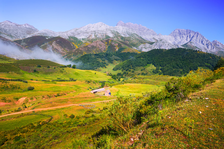 tranquil mountain landscape with  fog and farm in summer. Leon