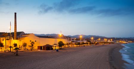 fabrica: Beach at Badalona in twilight. Catalonia, Spain Stock Photo
