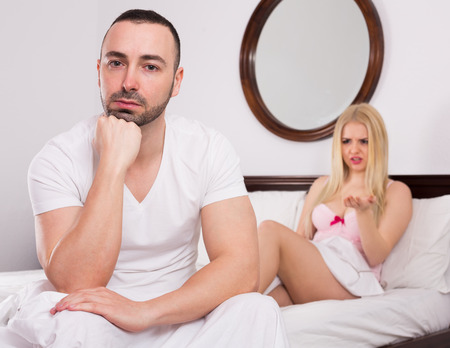 unsatisfied: Unsatisfied wife and sad young husband having big difficulties in bed