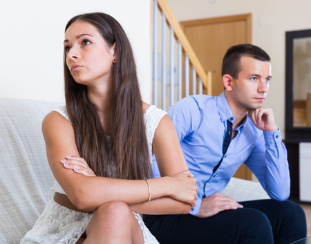 enmity: Domestic quarrel between offended husband and wife in the home Stock Photo