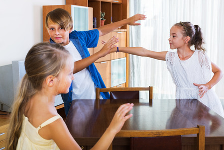 romp: Laughing child chasing other kids to tag or touch them