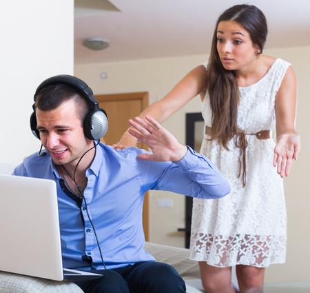 blaming: Stressed adult american girl blaming boyfriend in visiting date sites