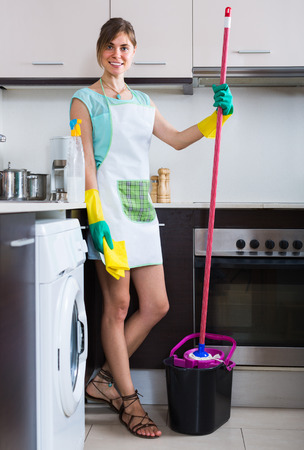 charwoman: Young maid doing professional clean-up in home interior