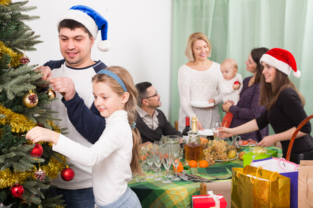 'food and beverage: Relatives gathered to celebrate Christmas with all family. Focus on girl Stock Photo