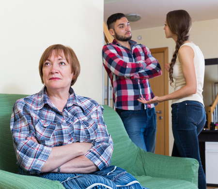 daughter in law: Young couple has a family conflict at home Stock Photo
