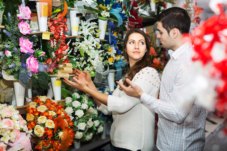 25 35: Man and woman choosing a bouquet at a flower shop Stock Photo