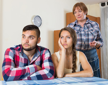 mother in law: Serious young childrens has a family conflict with there mother Stock Photo