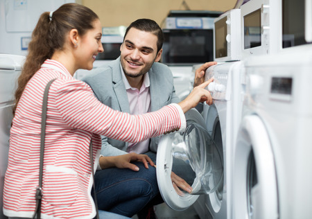 domestic appliances: portrait of salesman and  customer in store of domestic appliances