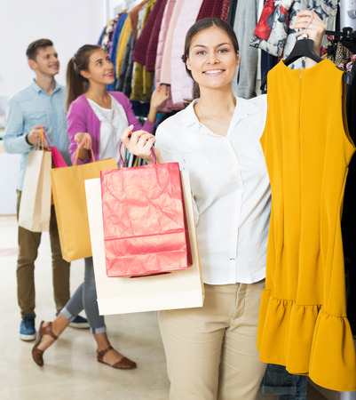 liked: Cheerful young woman customers chooses liked things in the boutique Stock Photo