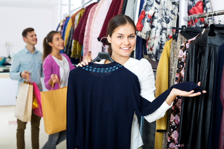 liked: Smiling woman customers chooses liked things in the boutique