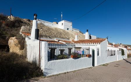chinchilla: Street with dwelling  caves into mount.  Chinchilla de Monte-Aragon, Albacete, Spain
