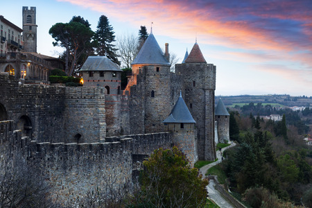 antiquary: Medieval  fortress walls in twilight   time.  Carcassonne, France