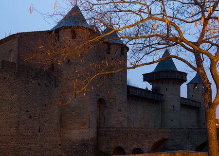 antiquary: Medieval Castle at Carcassonne in  twilight time.   Languedoc-Roussillon, France Stock Photo