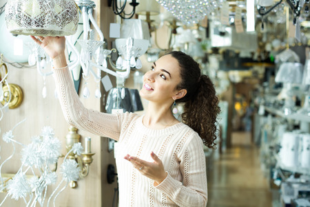 ordinary: Ordinary happy american woman doing shopping in lighting shop