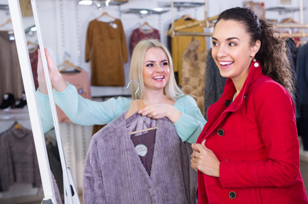 women shopping winter outwear at the apparel store