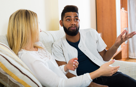 interracial family: Portrait of happy spouses joking and smiling indoors Stock Photo