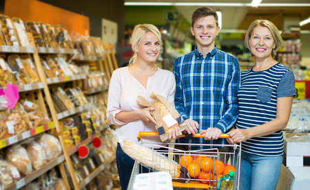 60 65: Attractive customers choosing bread and pastry in food hypermarket