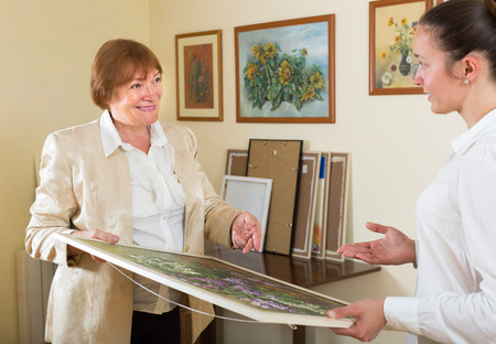 canvas art: Artist with buyer the picture in art gallery